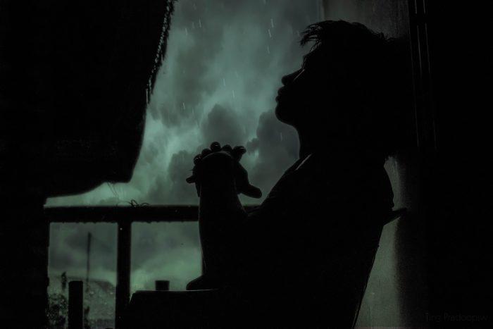 Adult Alone in Window